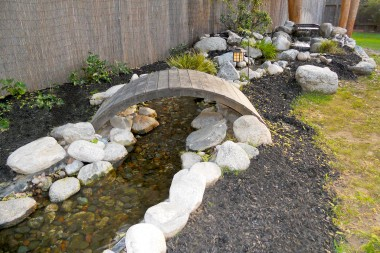Meandering waterfall that flows into the koi pond.  Nothing is more relaxing to eat outside on the patio, or lie in bed, while listening to the trickling water.