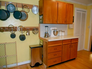 Alternate view of kitchen with preparation counter, and pantry behind louvered door.