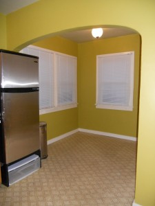 Spacious breakfast nook with built-in ironing board.  Refrigerator has already been removed from property; however, gas stove is included.