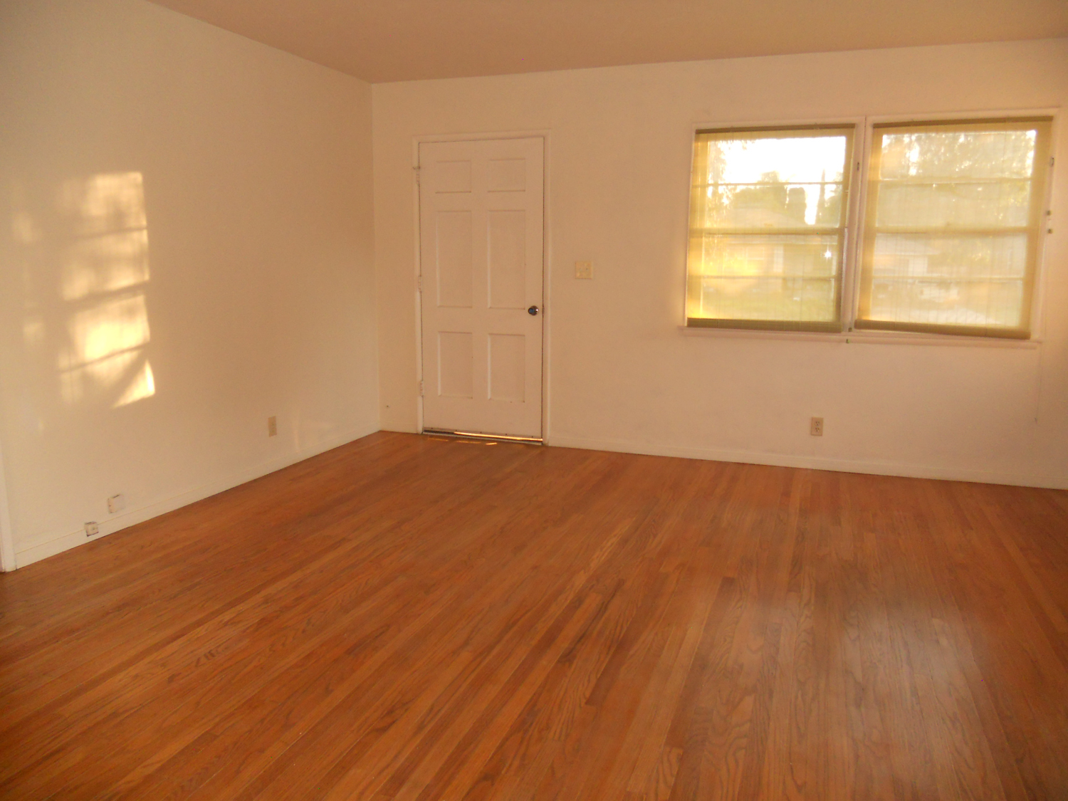 Living room with newly refinished hardwood floors.