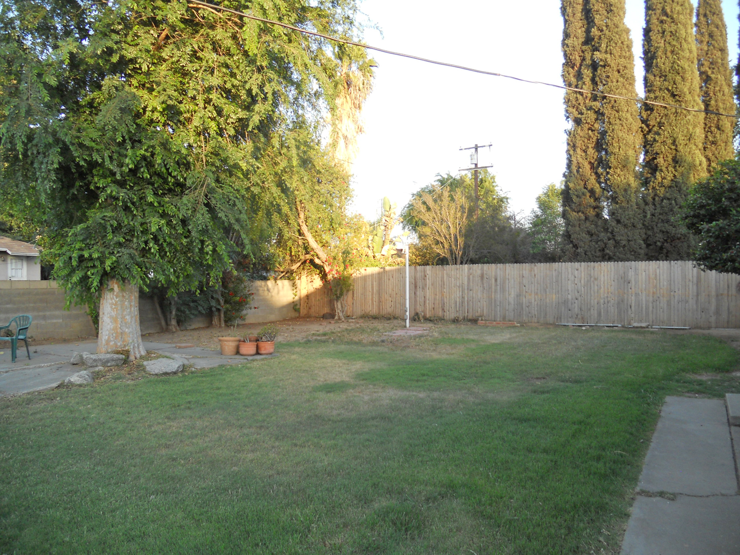 Large backyard -- enough room for pool and swing set, toys, etc.