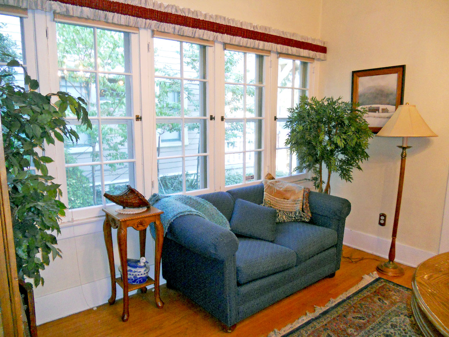 Alternate view of formal dining room with bank of original windows in beautiful condition that welcome the natural light.