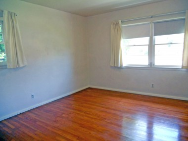 One of three bedrooms, all with gleaming hardwood floors.