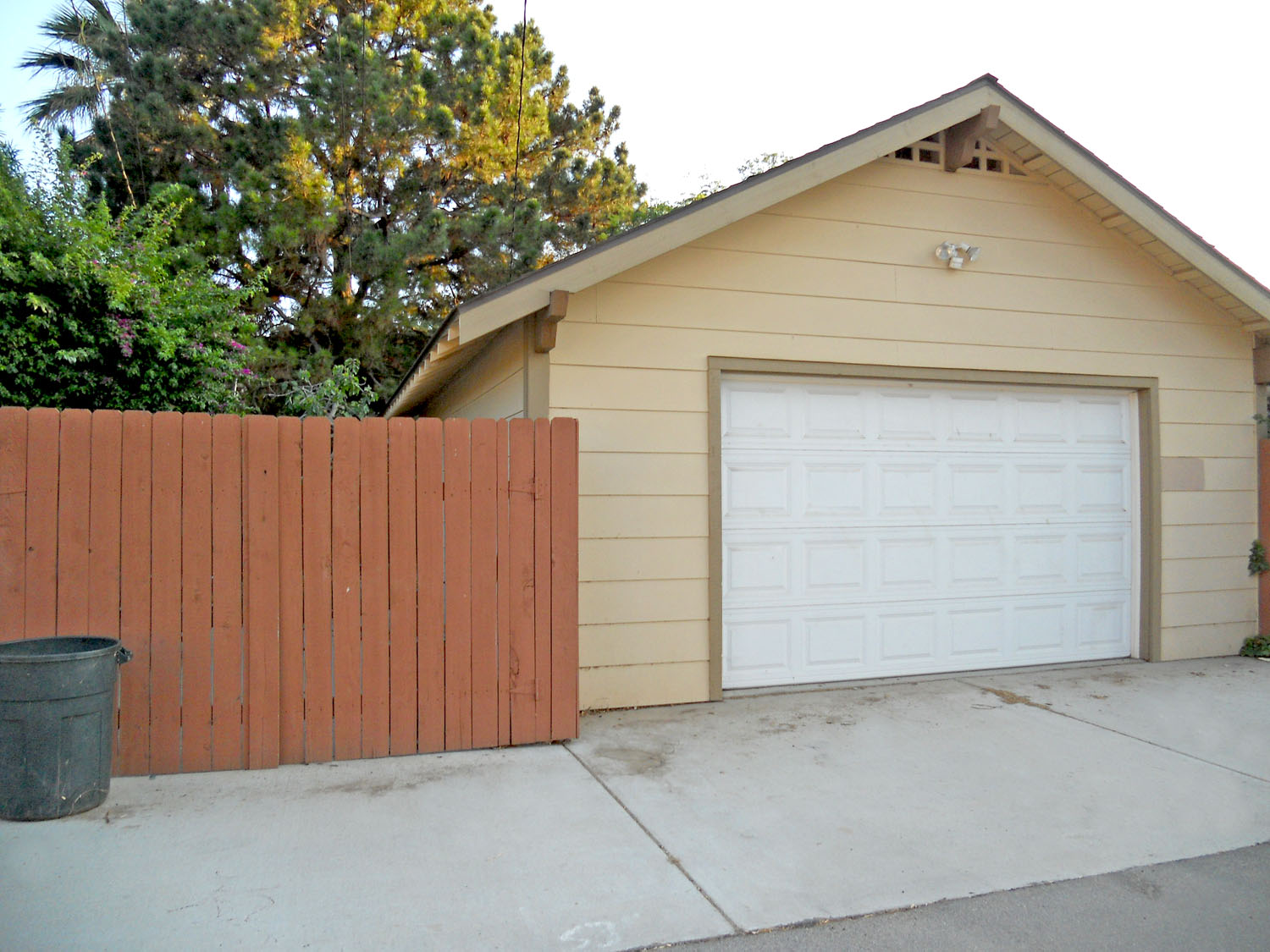 View of 2-car garage from paved alley.