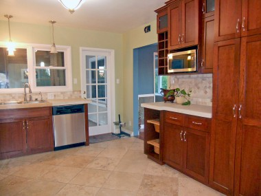 Alternate view of remodeled kitchen with French door to patio.