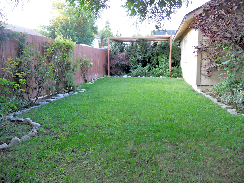 View of side yard next to garage.