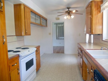 Spacious kitchen with nook area and lots of original cabinetry in like-new condition.