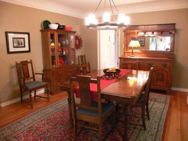 Exquisite formal dining room with coved ceiling and hardwood floors.