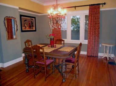 Large elegant formal dining room with high ceiling (high end curtains stay but not the chandelier -- a replacement will be installed prior to close of escrow).
