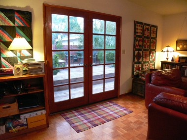 French doors lead to newer deck and built-in spa!