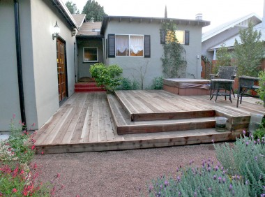 Renovated back yard deck with built-in spa.