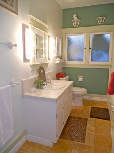 Updated bathroom with tile floor, newer vanity, brand new commode and tiled tub/shower enclosure.