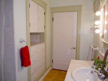 Alternate view of bathroom with ample cabinetry