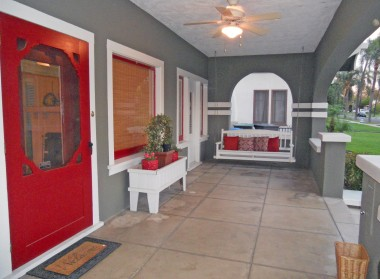 Huge gorgeous front porch with swing and mail slot.