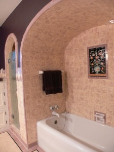 Extraordinary tiled tub along with separate shower stall, as well as original tiled floor.