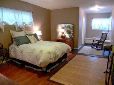 Master bedroom suite, complete with sitting area, walk-in closet, private bathroom, and separate entrance!