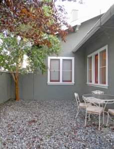 Side yard could be used as dog run or additional entertaining.