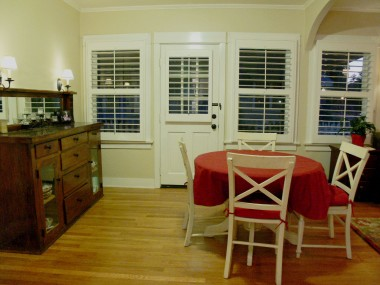Formal dining room with built-in hutch and convenient access to carport.