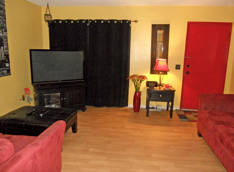Alternate view of living room, looking towards front door.