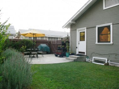 Alternate view of backyard and patio area.