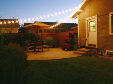 Evening view of back patio with twinkle lights.