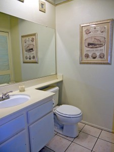 Downstairs powder room (half bath) with laundry facilities (currently set up for side-by-side units, but could also accommodate a stackable unit).