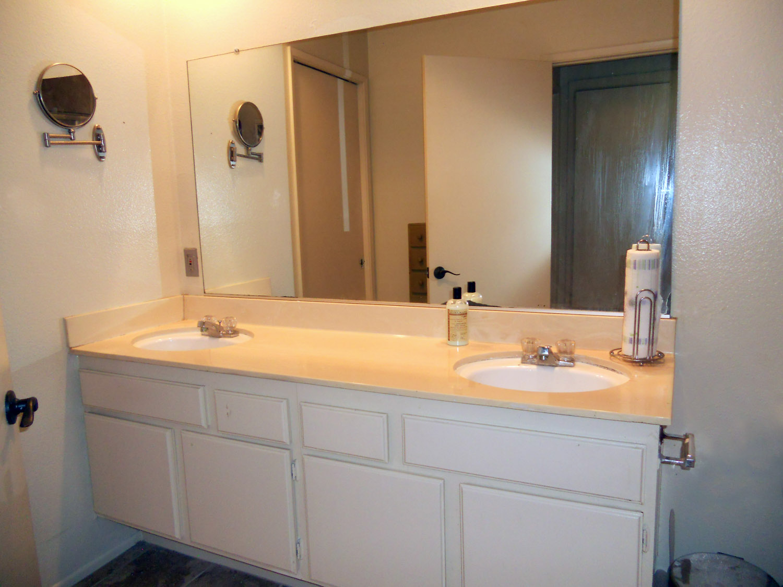 Upstairs hallway bathroom with dual sinks.