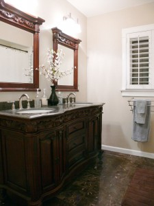 Completely remodeled bathroom (marble, new copper plumbing, tiled shower enclosure, Basswood Plantation window shutters, dual sinks).