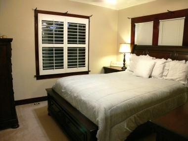 Front bedroom with original wood trim around windows, closets and doorway!