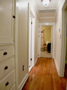 Gorgeous original hardwood floors in the hallway leading to bedrooms and remodeled bathroom.