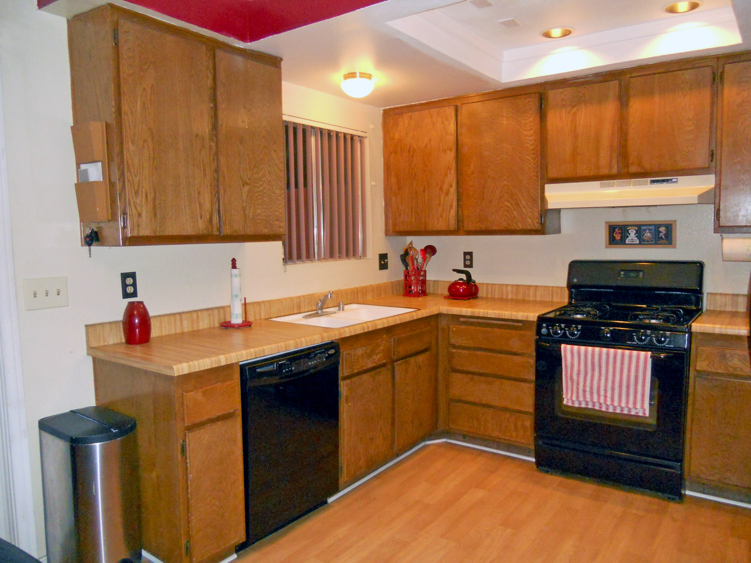 Spacious kitchen with ample cabinetry, dishwasher and gas stove.