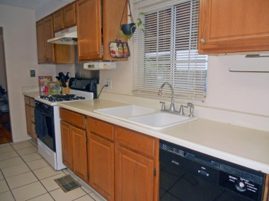 Updated kitchen with dishwasher, gas stove and lots of cabinetry.