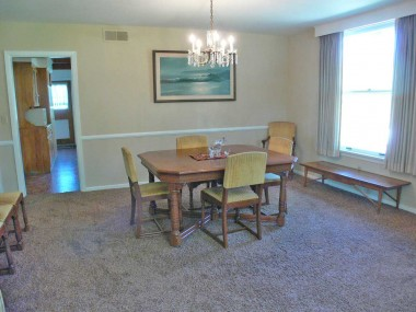 Large formal dining room with lots of natural light.