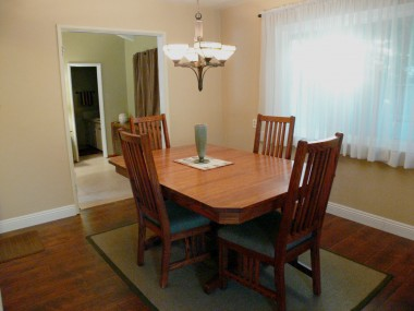 Formal dining room with brand new laminate flooring (looks like real wood) and new baseboards.