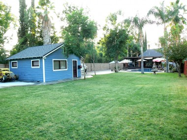 View from backyard towards garage and house.