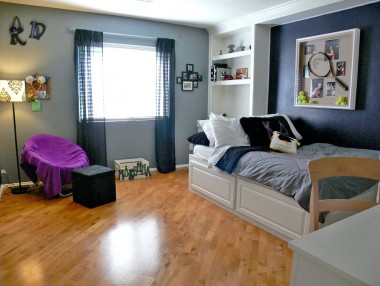 One of the four upstairs bedrooms with built-in shelving.