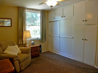 One of the two downstairs bedrooms with lots of closet space.