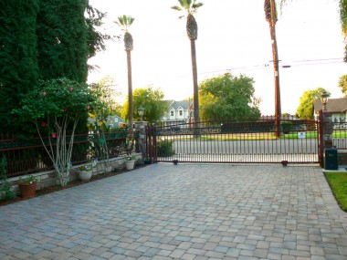 View of Systems pavers and electric driveway gate (with remote and a fire department box).