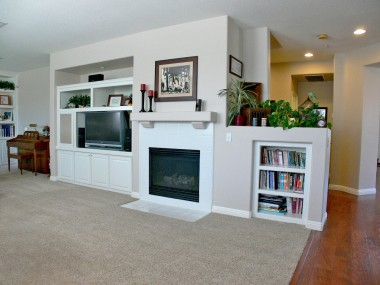 Alternate view of family room fireplace and entertainment center.
