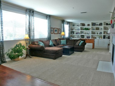 Gigantic family room with built-ins and lots of windows with natural light.
