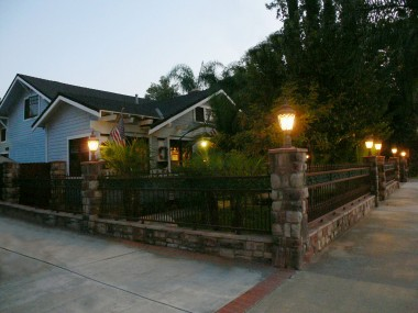 Alternate dusk view of front of home with pillar lights.