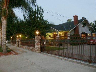 Dusk view of front of home with sensor lights.