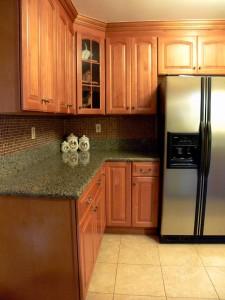 Remodeled kitchen with tile back splash.