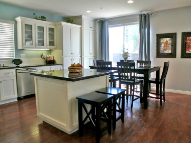 Remodeled kitchen with island and eating area overlooking the expansive backyard.
