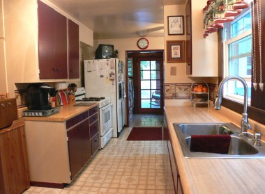 Kitchen with gas appliances and ample cabinetry (more out of photo view).