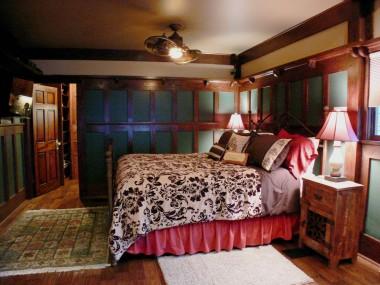 Main floor master bedroom suite with hardwood floors and custom-built walk-in closet.