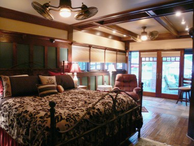 Alternate view of master suite with retreat and lovely French doors overlooking the resort-like backyard. Note the beamed ceiling, ceiling fans, and recessed lighting.