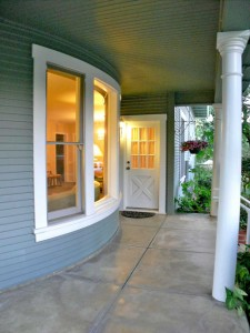 Wraparound porch with lunette window and semi-circular wall. Just spectacular!
