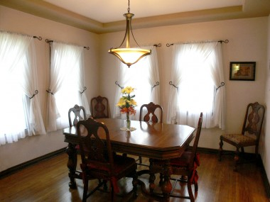 Formal dining room with tray ceiling and original hardwood floors in gorgeous condition.
