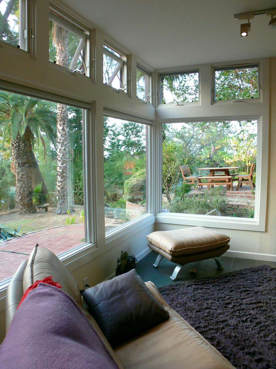 The lovely wall of windows overlooking the backyard. This home feels like an artist's retreat.